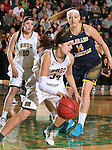 SPEARFISH, SD - MARCH 1, 2016 -- Christine Thorn #34 of Black Hills State dribbles away from Colorado Christian defender Kate Louthan #14 during their RMAC Shootout Quarterfinals Tuesday evening at the Donald E. Young Center in Spearfish, S.D.  Remi Wientjes #10 of Black Hills State is in the background.  (Photo by Dick Carlson/Inertia)