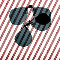 POLARIZED LIGHT<br /> Polarized Sunglass Visors At 45 Degree Angle<br /> (2 of 4)<br /> When lenses are at an acute angle to each other, partial transmission of light occurs. The intensity of light transmitted through 2 polarizers depends on the relative orientation of their transmission axes.