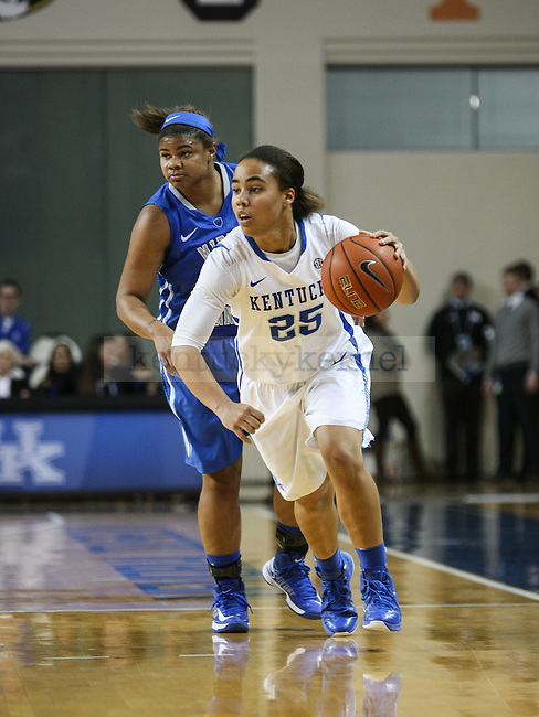 Kentucky guard Makayla Epps dribbles the ball during the first half of the UK Hoops game against Middle Tennessee State at Memorial Coliseum  on Friday, December 12, 2014 in Lexington, Ky. UK leads Middle Tennessee 41-26. Photo by Adam Pennavaria | Staff