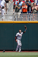 Oregon State outfielder Michael Conforto (8) holds up the ball after making a catch against the wall during Game 11 of the 2013 Men's College World Series against the Mississippi State Bulldogs on June 21, 2013 at TD Ameritrade Park in Omaha, Nebraska. The Bulldogs defeated the Beavers 4-1, to reach the CWS Final and eliminating Oregon State from the tournament. (Andrew Woolley/Four Seam Images)