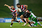 Tomasi Cama tackles a hard running Siale Piutau.  ITM Cup rugby game between Counties Manukau and Manawatu played at Bayer Growers Stadium on Saturday August 21st 2010..Counties Manukau won 35 - 14 after leading 14 - 7 at halftime.