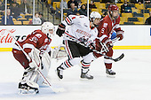 Ryan Carroll (Harvard - 35), Braden Pimm (Northeastern - 14), Danny Biega (Harvard - 9) - The Northeastern University Huskies defeated the Harvard University Crimson 4-0 in their Beanpot opener on Monday, February 7, 2011, at TD Garden in Boston, Massachusetts.