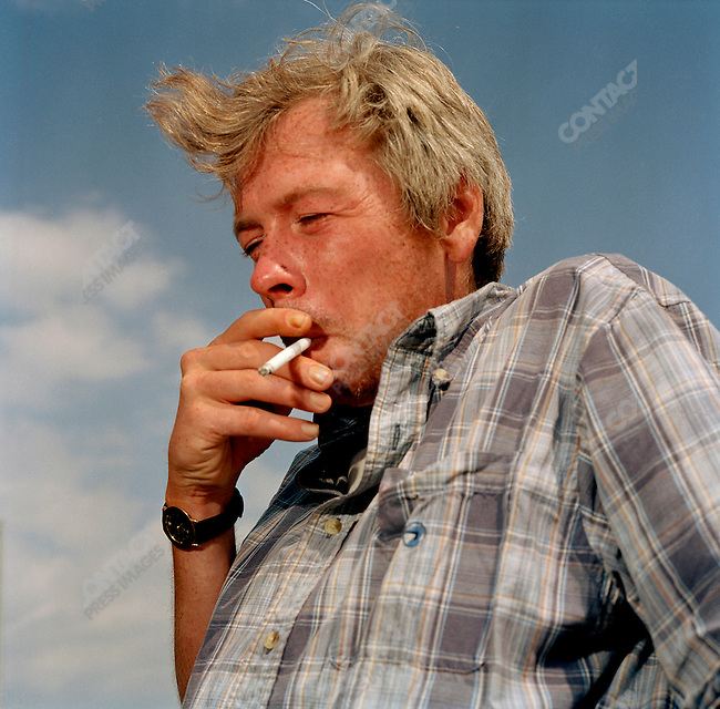 John Trainer, who died the following year, smokes a cigarette on the boardwalk, 2003