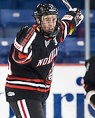 Mike McLaughlin (Northeastern - 18) celebrates after tying the game at 2 early in the third period. - The visiting Northeastern University Huskies defeated the University of Massachusetts-Lowell River Hawks 3-2 with 14 seconds remaining in overtime on Friday, February 11, 2011, at Tsongas Arena in Lowelll, Massachusetts.