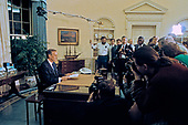 United States President George H.W. Bush poses for photos in the Oval Office of the White House in Washington, D.C. after announcing the start of the air offensive to liberate Kuwait after it was overrun by Iraq on January 16, 1991.<br /> Credit: Ron Sachs / CNP