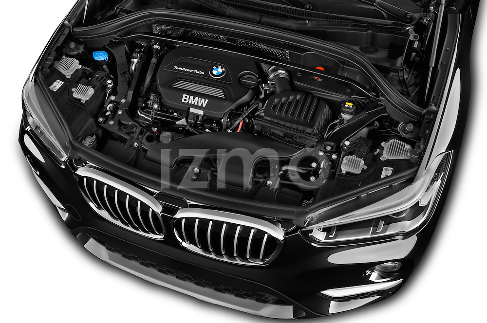 Car Stock 2016 BMW X1 xLine 5 Door Suv Engine  high angle detail view