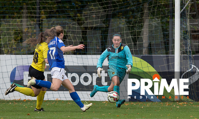 Goalkeeper Shayla Burgess of Watford Ladies collects the ball under pressure during the final FAWSL2 match of the 2015 season between Watford Ladies and London Bees at Berkhamsted FC, Berkhamstead, England on 18 October 2015. Photo by Andy Rowland.