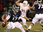 Nevada quarterback Cody Fajardo scrambles under pressure from Fresno State during the first half of an NCAA college football game in Reno, Nev., on Saturday, Nov. 22, 2014. Fresno State won 40-20. (AP Photo/Cathleen Allison)