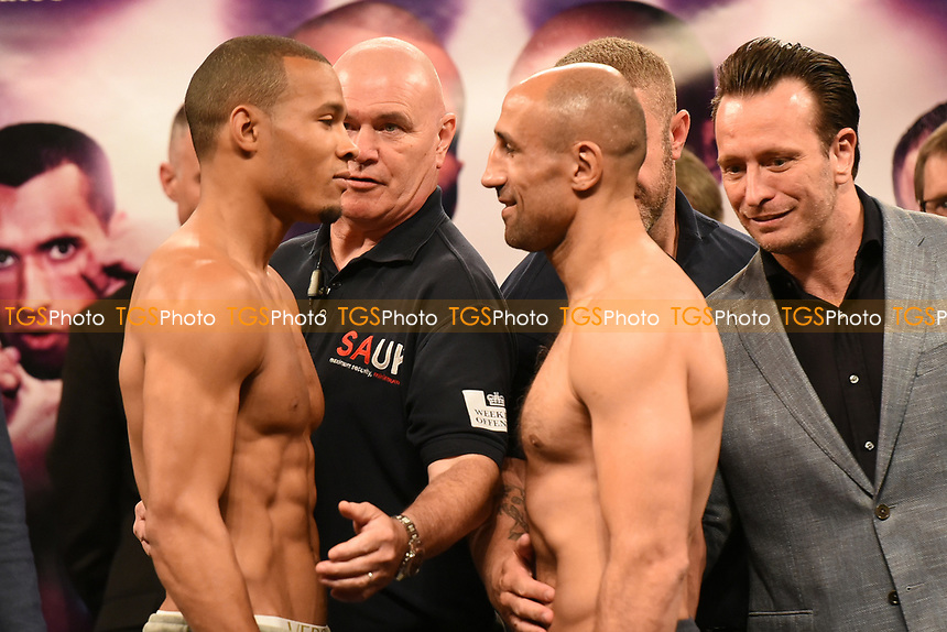 Chris Eubank Jr (L) and Arthur Abraham are held apart as they go head-to-head during a Weigh-In at the SSE Arena on 14th July 2017