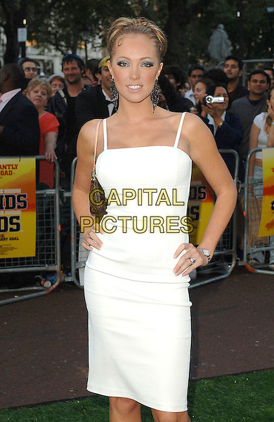 """AISLEYNE HORGAN-WALLACE.Attending the World Charity Premiere of """"In The Hands Of The Gods"""", Odeon West End, London, England..September 10th, 2007.half 3/4 length white dress Horgan Wallace Big Brother 7 hands on hips .CAP/ BEL.©Tom Belcher/Capital Pictures."""