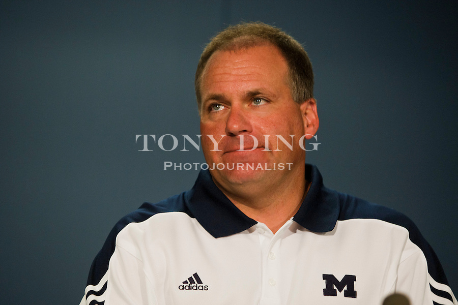 Michigan head coach Rich Rodriguez listens to a question at a press conference during the annual NCAA college football media day, Sunday, Aug. 22, 2010, in Ann Arbor, Mich. (AP Photo/Tony Ding)
