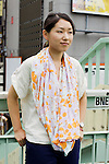 August 8, 2012, Tokyo, Japan - Eri, 27, Fine Art Photographer. Today's fashion point - summer scarf because it has a strong appearance with the light colored clothing that I'm wearing. Favorite brand - Ciaopanic because its casual and stylish. Bought clothing from - Scarf was a gift from a friend, Top shirt is from Ciaopanic, pants from Ginza and watch from Fossil. Favorite fashion style - a good balance of both elegant and casual fashion. Favorite place - Yurakucho area because there are many stores in the area and it's close to Ginza. (Photo by Christopher Jue/Nippon News)