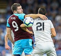 Burnley's Sam Vokes battles with Aberdeen's Dominic Ball<br /> <br /> Photographer Alex Dodd/CameraSport<br /> <br /> UEFA Europa League - Europa League Qualifying Round 2 2nd Leg - Burnley v Aberdeen - Thursday 2nd August 2018 - Turf Moor - Burnley<br />  <br /> World Copyright © 2018 CameraSport. All rights reserved. 43 Linden Ave. Countesthorpe. Leicester. England. LE8 5PG - Tel: +44 (0) 116 277 4147 - admin@camerasport.com - www.camerasport.com