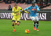 Joao Filho  challenges Napoli's Kalidou Koulibaly   during the Quartef-final of Tim Cup soccer match,between SSC Napoli and vFC Inter    at  the San  Paolo   stadium in Naples  Italy , January 19, 2016