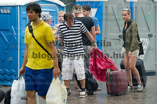 Participants carry their bags while moveing in to Sziget festival held in Budapest, Hungary on August 07, 2011. ATTILA VOLGYI