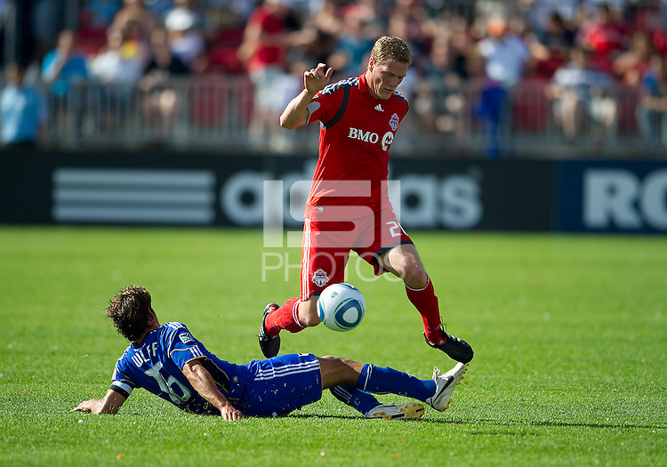 05 June 2010: Kansas City Wizards forward Josh Wolff #16 battles with Toronto FC defender Ty Harden #20 during a game between the Kansas City Wizards and Toronto FC at BMO Field in Toronto..The game ended in a 0-0 draw.