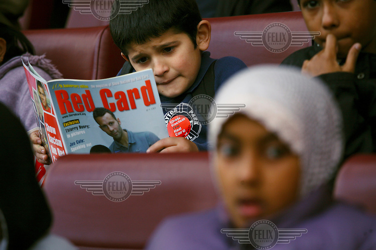 Pupils from Drayton Park school take part in a Show Racism The Red Card Initiative, which UNISON helped establish in 1996, at Arsenal Football Club's Emirates Stadium in Highbury, London.