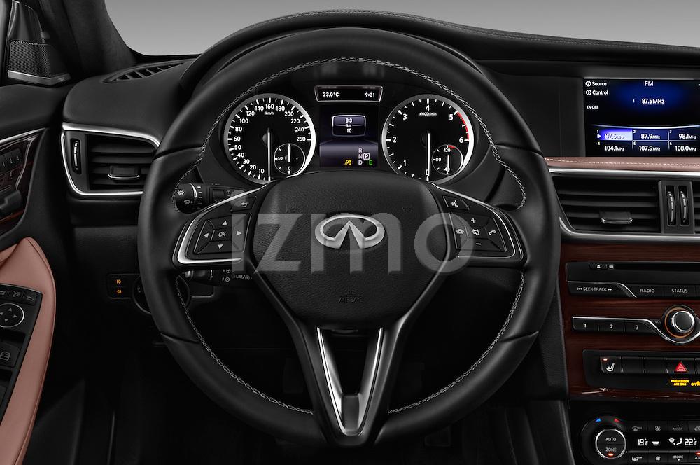 Car pictures of steering wheel view of a 2017 Infiniti QX0 Premium-Tech-4wd 5 Door Suv Steering Wheel