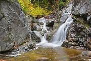Flume Cascade in Hart's Location, New Hampshire during autumn months. This waterfall is roadside along Route 302 in Crawford Notch State Park.
