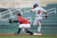 Justin Yurchak (33) of the Kannapolis Intimidators catches the throw as Josh Stephen (8) of the Lakewood BlueClaws steps on first base at Kannapolis Intimidators Stadium on April 6, 2018 in Kannapolis, North Carolina.  The BlueClaws defeated the Intimidators 4-3. (Brian Westerholt/Four Seam Images)