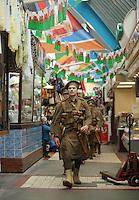 Men in World War I gear in Swansea Market, south Wales UK. Friday 01 July 2016