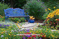 63821-21703 Blue bench, blue container, and stone path in flower garden.  Black-eyed Susans (Rudbeckia hirta) Red Dragon Wing Begonias (Begonia x hybrida) Homestead Purple Verbena, New Gold Lantana, Red Verbena, Butterfly Bushes, Sedum, Croton in blue pot, Marion Co., IL