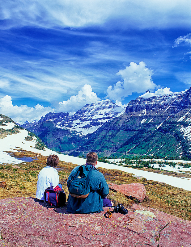Couple enjoying view near Logan Pass. Glacier National Park, Montana.