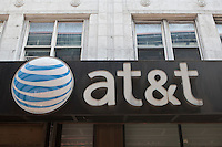 An AT&T store is pictured in New York City, NY Monday August 1, 2011. AT&T Inc. (NYSE: T) is an American multinational telecommunications corporation and largest provider of mobile telephony and fixed telephony in the United States.
