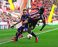 Sheffield United's Ethan Ebanks-Landell vies for possession with Charlton Athletic's Tony Watt<br /> <br /> Photographer Chris Vaughan/CameraSport<br /> <br /> The EFL Sky Bet League One - Sheffield United v Charlton Athletic - Saturday 18th March 2017 - Bramall Lane - Sheffield<br /> <br /> World Copyright &copy; 2017 CameraSport. All rights reserved. 43 Linden Ave. Countesthorpe. Leicester. England. LE8 5PG - Tel: +44 (0) 116 277 4147 - admin@camerasport.com - www.camerasport.com