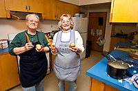 Volunteer cooks Debbie Smykalski (L) and Joan Patterson in the kitchen at the Nome Community Methodist church during the 2010 Iditarod