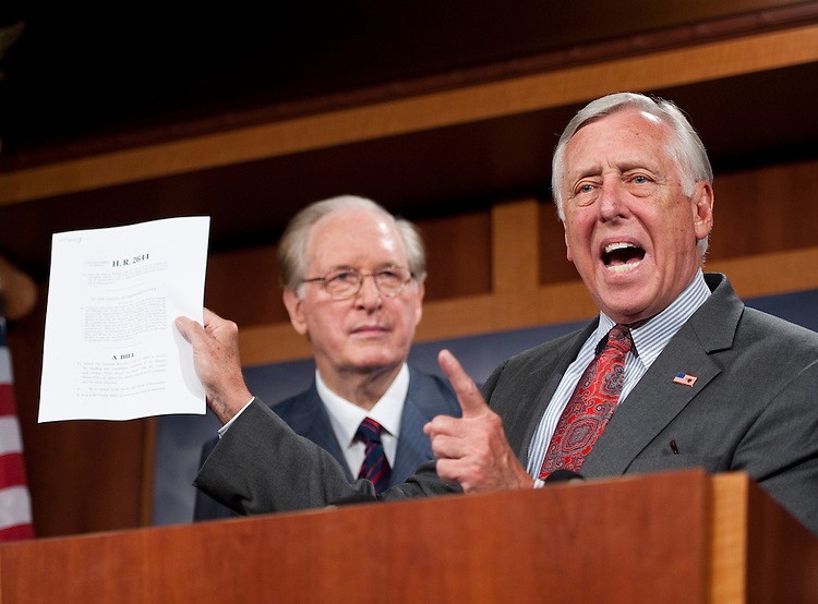 "UNITED STATES - AUGUST 3: House Minority Whip Steny Hoyer, D-Md., flanked by Senate Commerce, Science and Transportation Chairman John ""Jay"" Rockefeller, D-W.Va., speaks during a news conference on the Federal Aviation Administration on Wednesday, Aug. 3, 2011. Hoyer is holding a copy of H.R. 2644, the Aviation Jobs and Safety Act of 2011. (Photo By Bill Clark/Roll Call)"