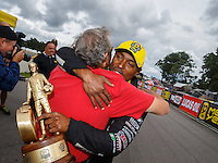 Aug 20, 2016; Brainerd, MN, USA; NHRA top fuel driver Antron Brown celebrates with team owner Don Schumacher after winning the Protect the Harvest Nationals from Seattle, WA that was delayed by rain to run during qualifying for the Lucas Oil Nationals at Brainerd International Raceway. Mandatory Credit: Mark J. Rebilas-USA TODAY Sports