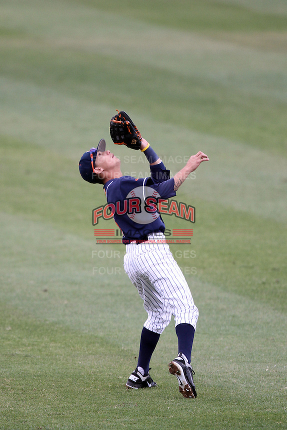 Richie Pedroza #6 of the Cal. St. Fullerton Titans catches a fly ball against the Cal. St. Long Beach 49'ers at Goodwin Field in Fullerton,California on May 14, 2011. Photo by Larry Goren/Four Seam Images