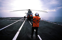 "The Italian aircraft carrier  ""G. Garibaldi""..Antisubmarine helicopters SH-3D in flight night..flight deck staff"