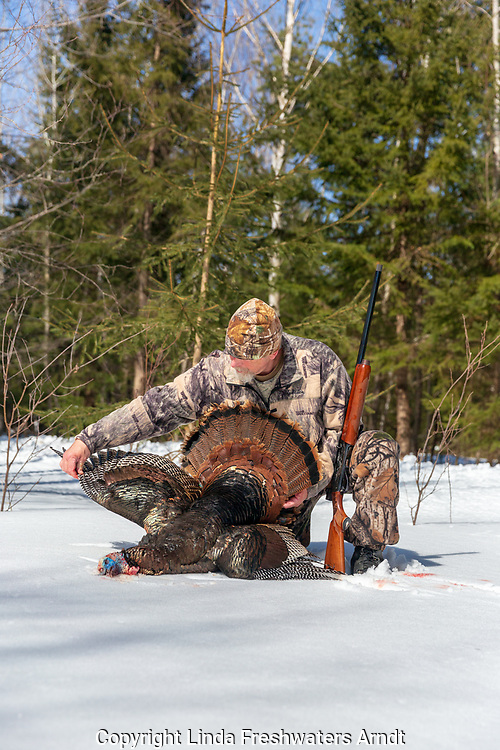 Hunter posing with his spring turkey in northern Wisconsin.