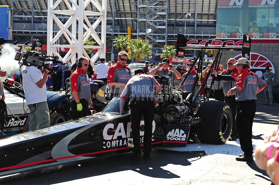 Oct. 30, 2011; Las Vegas, NV, USA: NHRA crew members for top fuel dragster driver Steve Torrence during the Big O Tires Nationals at The Strip at Las Vegas Motor Speedway. Mandatory Credit: Mark J. Rebilas-