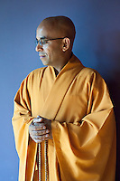 A buddhist monk in preparation for a blessings ceremony at Prana Yoga Center in Geneva, IL.
