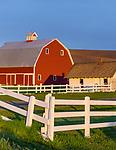 The Palouse, Whitman County, Washington: Red barn and farm scene in evening light