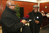 0398 – 5th Ward candidate, Norm Bolden spoke with Marcel Coleman during a meet and greet at 4850 S. Lake Park Ave.