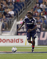 New England Revolution midfielder Shalrie Joseph (21) brings the ball forward. The New England Revolution tied Columbus Crew, 2-2, at Gillette Stadium on September 25, 2010.