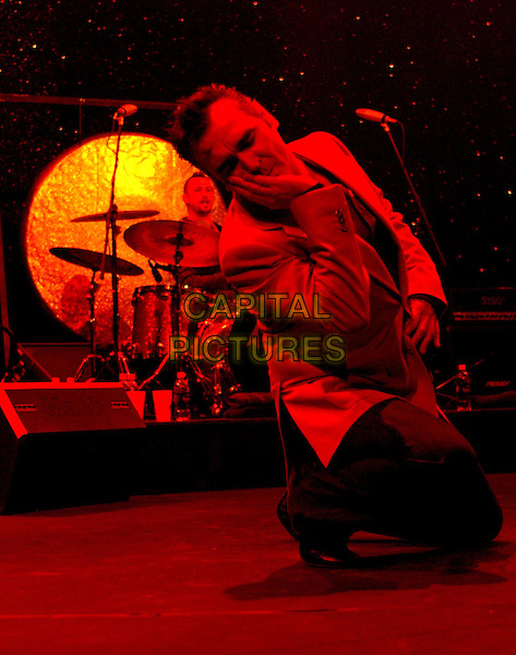 "MORRISSEY.Morrissey performs live to a sold out crowd to promote his upcoming album ""You are the Quarry"" The show was the first of his Southern California performances, at The Grove of Anaheim,.18th April 2004.half length half-length concert gig on stage singing red jacket music kneeling .*UK sales only*.www.capitalpictures.com.sales@capitalpictures.com.©Capital Pictures"