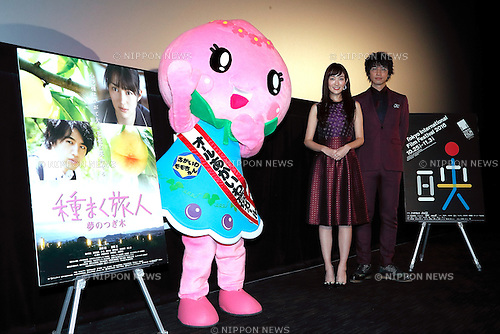 (L to R) Mascot character of Akaiwa City Momo Akaiwa, actress Rin Takanashi and actor Takumi Saitoh pose for the cameras during a stage greeting for the film The Sowing Traveller 3 at TOHO CINEMAS in Roppongi Hills on October 28, 2016, Tokyo, Japan. The screening is part of the 29th Tokyo International Film Festival which is one of the biggest film festivals in Asia where fans can get close to actors and directors during the stage greetings. TIFF is the only Japanese festival accredited by the International Federation of Film Producers Associations (FIAPF) and runs from October 25 til November 3. (Photo by Rodrigo Reyes Marin/AFLO)