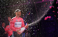 champagne &amp; La Maglia Rosa for birthday boy (37) Svein Tuft (CAN/Orica-GreenEdge)<br /> <br /> Giro d'Italia 2014<br /> stage 1: TTT