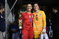 CHARLOTTE, NC - OCTOBER 03: Ali Krieger #11 with the WC Trophy and Ashlyn Harris #18 of the United States prior to their game versus Korea Republic at Bank of American Stadium, on October 03, 2019 in Charlotte, NC.