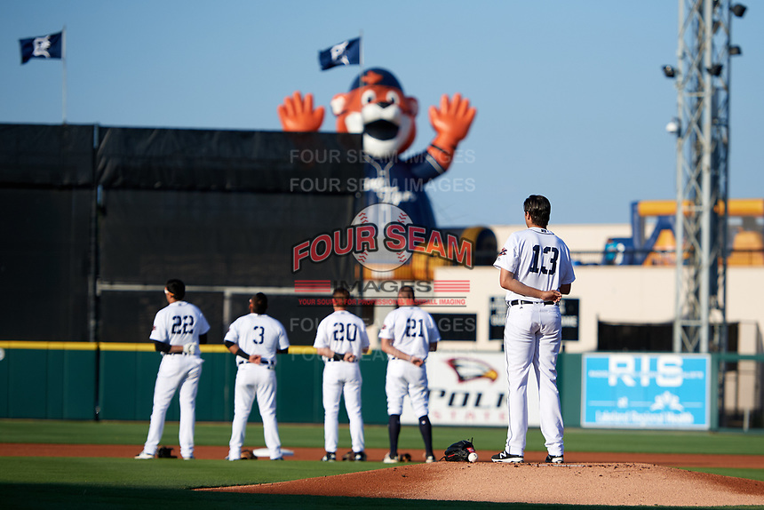 Lakeland Flying Tigers starting pitcher Alex Faedo (13) stands on the mound during the national anthem before a game against the Tampa Tarpons on April 6, 2018 at Publix Field at Joker Marchant Stadium in Lakeland, Florida.  Infielders Danny Pinero (22), Isaac Paredes (3), Chad Sedio (20), and Blaise Salter (21) stand at second base.  Lakeland defeated Tampa 6-5.  (Mike Janes/Four Seam Images)