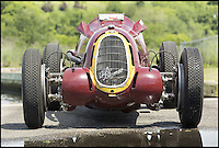 BNPS.co.uk (01202) 558833<br /> Picture: Bonhams/BNPS<br /> <br /> Historic Alfa Romeo Grand Prix winning racing car set to sell for a world record &pound;6.5 million at the Goodwood Revival this weekend.<br /> <br /> The 77 year old Italian machine was designed to take on the might of Hitler's all conquering Mercedes 'Silver Arrows' in the 1930's and bring glory to Mussolini in a sporting battle of the dictators.<br /> <br /> One of the most collectable cars in the world, the magnificent machine, which is in full working order having been restored, won a host of Grand Prix races all over the world before the Second World War. It is being sold by auctioneers Bonhams at its Goodwood Revival sale this Saturday.