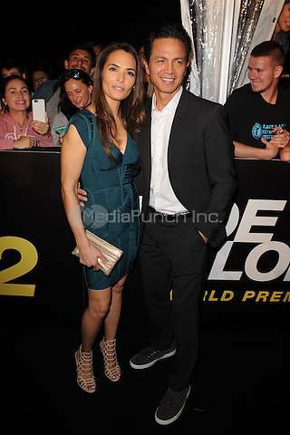 MIAMI BEACH, FL - JANUARY 06: ITalisa Soto and Benjamin Bratt attend the world premiere of 'Ride Along 2' at Regal South Beach Cinema on January 6, 2016 in Miami Beach, Florida. Credit: mpi04/MediaPunch