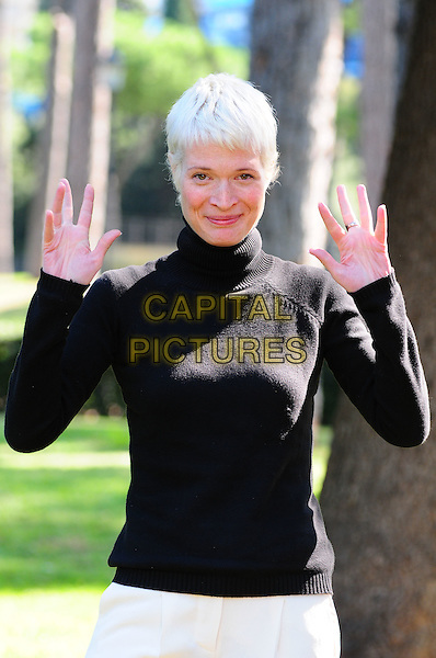 "JANE ALEXANDER .Photocall for Film ""Anna e i cinque"" Rome, Italy, September 26th 2008..half length black polo neck top jumper hands waving .CAP/CAV.©Luca Cavallari/Capital Pictures"