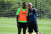 Joel Asoro of Swansea City takes instructions from Mike Marsh, assistant first team coach for Swansea City during the Swansea City Training at Fairwood Training Ground in Swansea, Wales, UK.  Thursday 18 July 2019