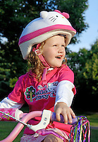 Smiling five year old girl with bike safety helmet.